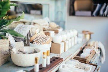 Cosmetic products in white packages on the table