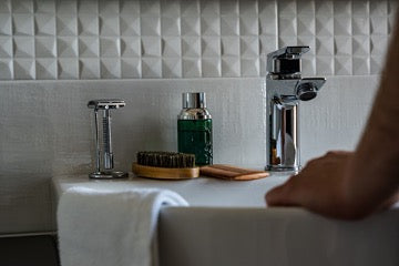 A white towel hangs on the edge of the sink