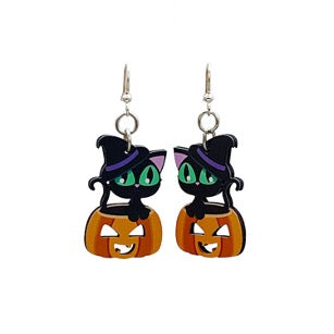 Earrings in the form of a black cat sitting on a pumpkin