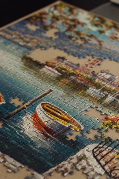 Puzzles partially assembled into a picture