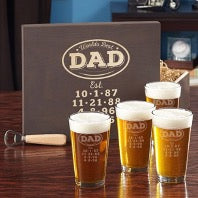 4 beer glasses with beer and a package with the words