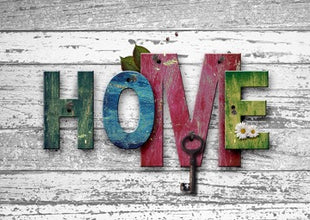 Wall with multicolored letters HOME