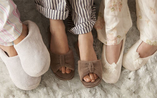 Feet of three women dressed in cashmere slippers