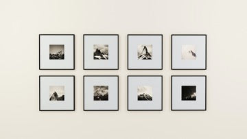 Gallery wall with eight framed small pictures