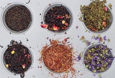 Six containers with different types of tea