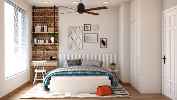 A bright room with a large window, a bed with white and blue linens, a white carpet and shelves on a brick wall