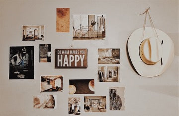 Light wall with photographs and hat