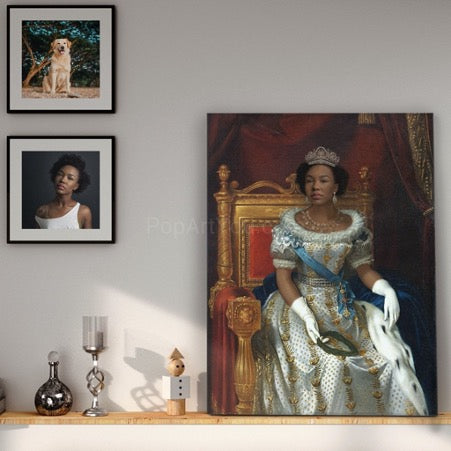 There is a portrait of a woman in a royal costume on a wooden shelf, while a portrait of a dog and a portrait of a woman hang on a white wall