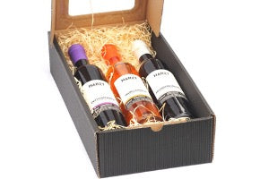 Set of three bottles of wine in a carton box