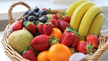 Basket with fruits and berries