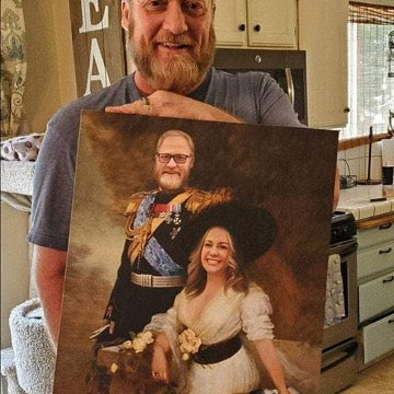 A bearded man in a gray t-shirt holds a portrait of himself with a woman dressed in historical royal clothing