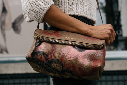 Burberry leather purse in a woman's hand