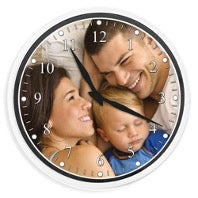 Clock with a portrait of a family of women, men and children on the dial