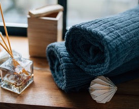 Two blue towels on a wooden table
