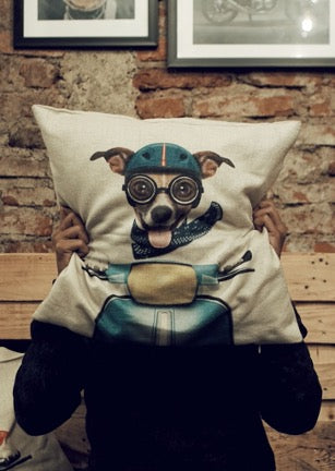 Pillow with print of a dog in a motorcycle helmet and goggles driving a motorcycle