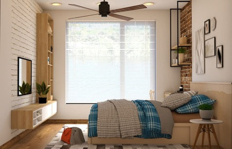 A bright room with a large window, a bed with white and blue linens and a bedside table