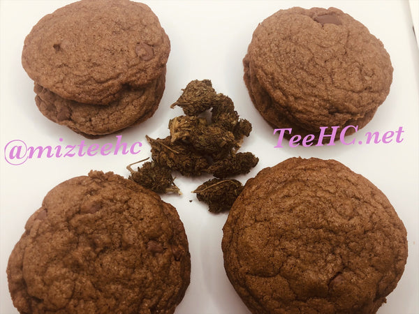 4 stacks of chocolate chip cookies with 4 weed nuggets in middle on white background
