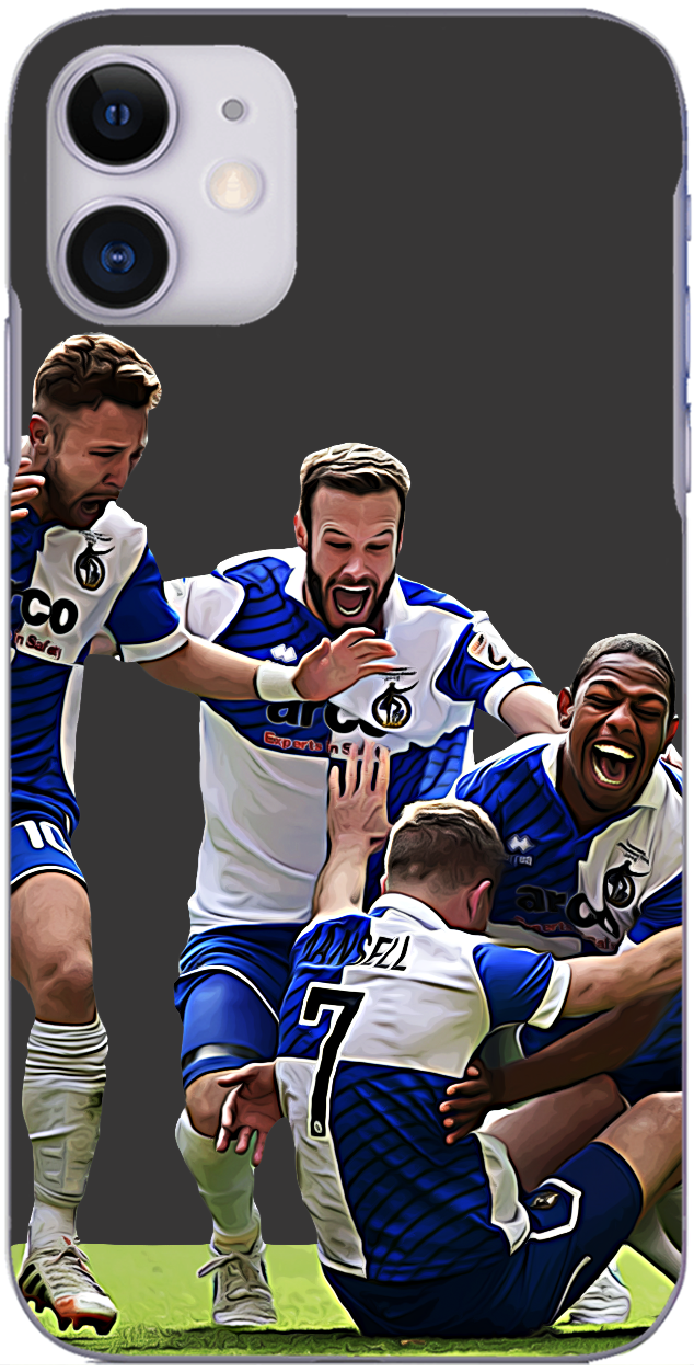 Bristol Rovers - Lee Mansell is mobbed after netting winning penalty play off final 2015