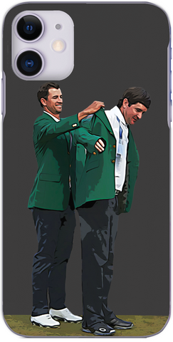 Bubba Watson receives the Green Jacket from Adam Scott after winning The Masters 2014
