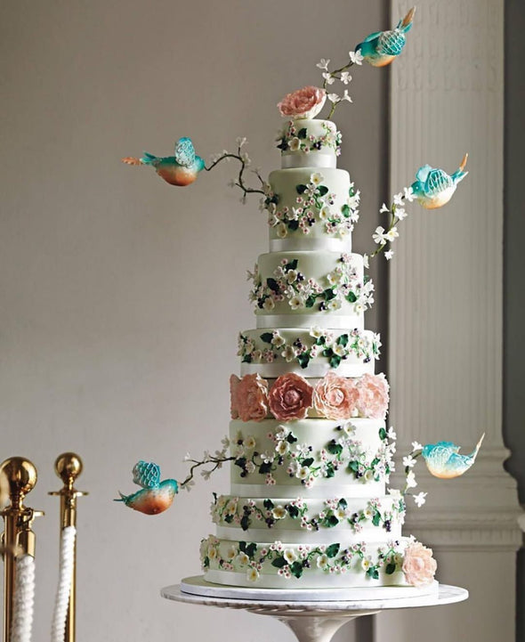 Bluebirds dressing cake mid air - Tuck Box Cakes