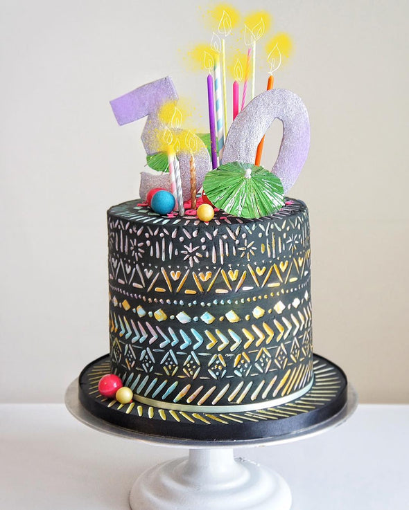 Neon tribal carved cake - Tuck Box Cakes