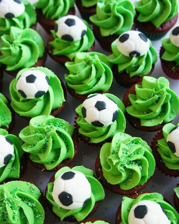 Football mini cupcakes - Tuck Box Cakes