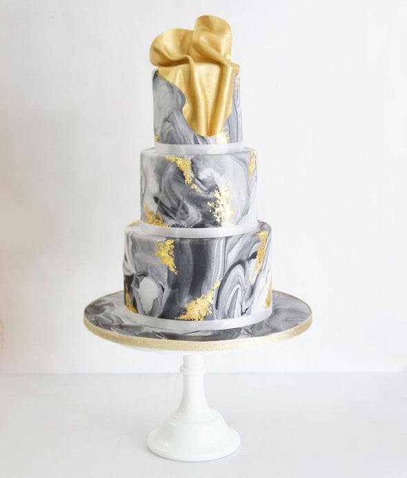 Marble and liquid gold cake - Tuck Box Cakes
