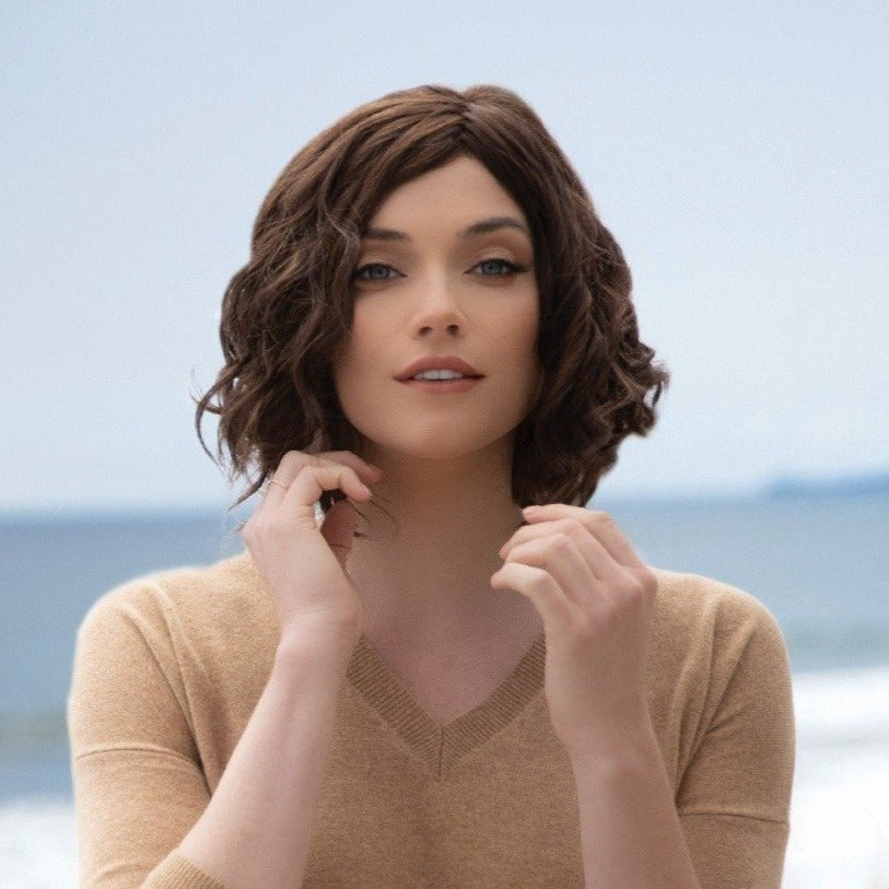Short-length synthetic wig. This wavy ready-to-wear wig is a playful bob with spiral curls all around. This trendy bob has a new lace and front partial monofilament cap. Its lace front will give you a natural look with the partial monofilament base. Julie's cap construction has adjustable tabs in the back nape area to allow a more comfortable fit. The result is a comfortable fit with a natural look that is both fashionable and easy to wear.