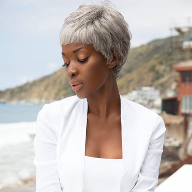 Short-length synthetic wig. This straight ready-to-wear wig is a fashion forward pixie with tapered nape. Gabby is machine made with adjustable tabs in the back nape area to allow a more comfortable fit. The result is a comfortable fit with a natural look that is both fashionable and easy to wear. Shown in Silver Stone