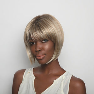 Short-length synthetic wig. This straight ready-to-wear wig is a sleek A-Line cut with full fringe.  Angie is machine made with adjustable tabs in the back nape area to allow a more comfortable fit. The result is a comfortable fit with a natural look that is both fashionable and easy to wear. Shown in Creamy Toffee-R