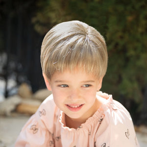 Synthetic childrens short unisex style wig with bangs.  Lace front and lace part cap make this a realistic option.  Shown in Creamy Toffee.