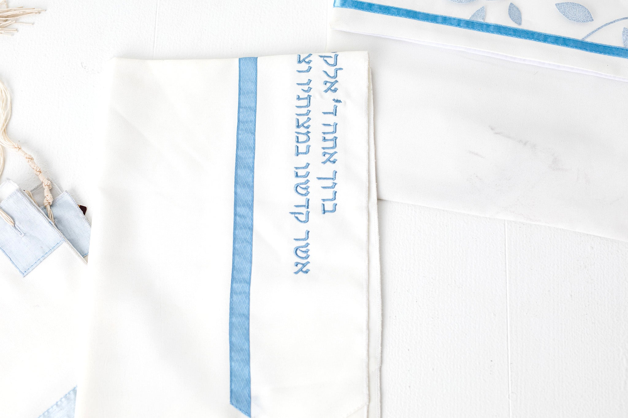 Tallit- Ivory tallit with light blue floral design with a bit of sparkle