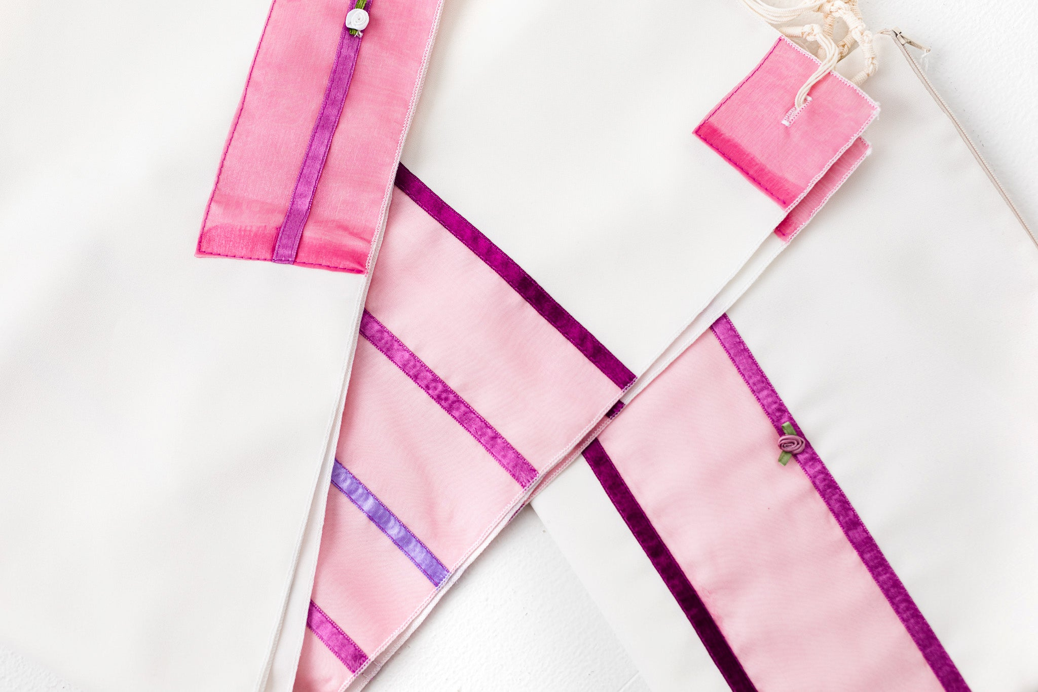 Tallit- Gorgeous off white with pink and purple trim.  Adorned with delicate flower appliques.