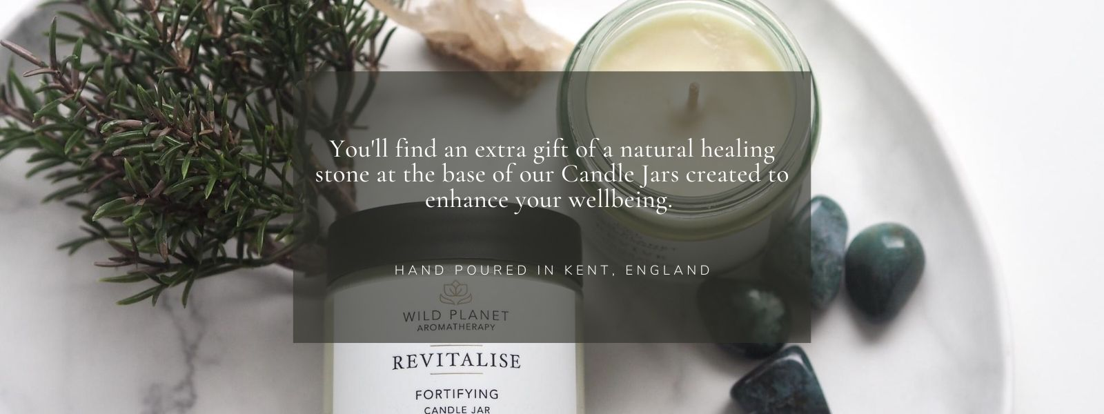Revitalise Candle Jars with Green Moss Agate next to rosemary on marble tray by Wild Planet Aromatherapy