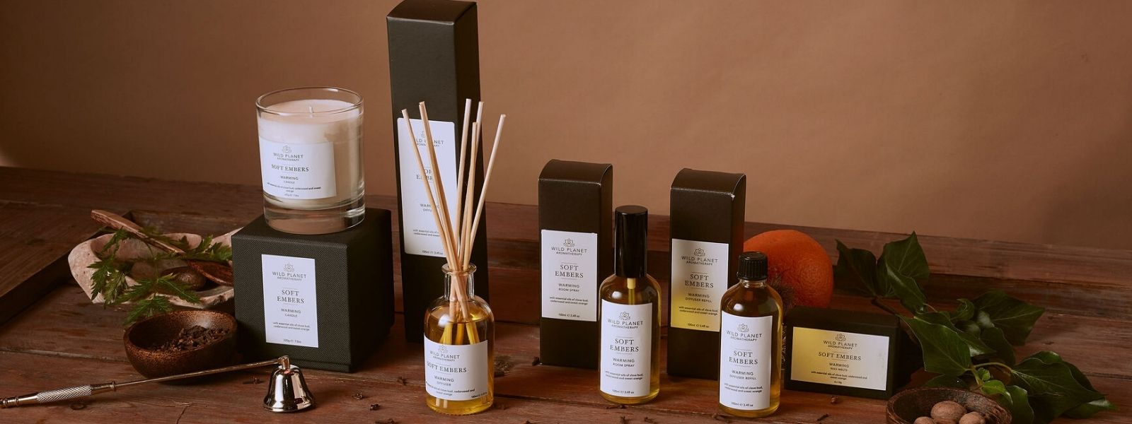 Soft Embers candle, reed diffuser, room spray and wax melts by Wild Planet Aromatherapy on wooden table
