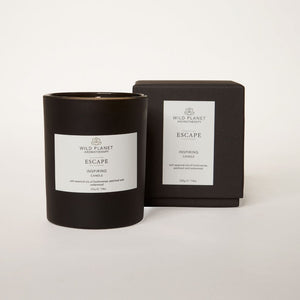 Matt black glass Escape Meditation Candle next to black branded box