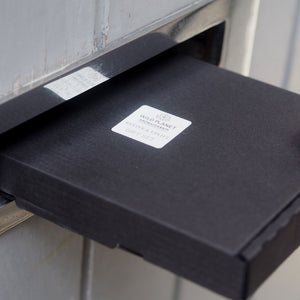 Luxury Letterbox Gift posted through chrome letterbox in grey door by Wild Planet Aromatherapy