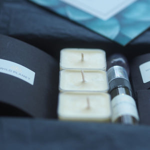 Opened Sleep Letterbox gift with tea lights, pillow mist, scented sachet by Wild Planet Aromatherapy
