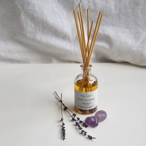 Deep Slumber organic reed diffuser bottle and reeds with amethyst with lavender flowers