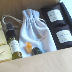 Opened Luxury Letterbox gift Revive and Uplift with tea lights, room spray, crystals and wax melts