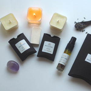 Flatlay of Sleep Pillow Mist, wax melts, tea lights, amethyst crystal by Wild Planet Aromatherapy