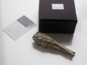 Pure White Sage Smudge Stick next to black box with instruction card by Wild Planet Aromatherapy