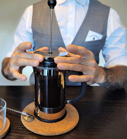 The plunger on the French Press dancing ox Coffee roasters