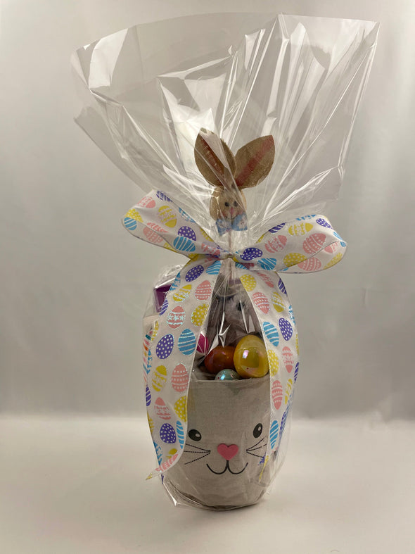 Blue Bunny Basket includes:   Bluebunny fabric basket that can be reused  Russell Stover cookies and crème chocolate bunny - Cookies and crème cookie pieces in white fudge   Sour Patch Kids Bunnies or Warheads Chewy Bunnies (please note candy variety varies)  Stuffed bunny animal  Bunny ball thrower toy  Bunny canvas bag with floppy ears filled with candy variety  Iridescent eggs with Hersey's variety chocolate   Burlap bunny package decoration