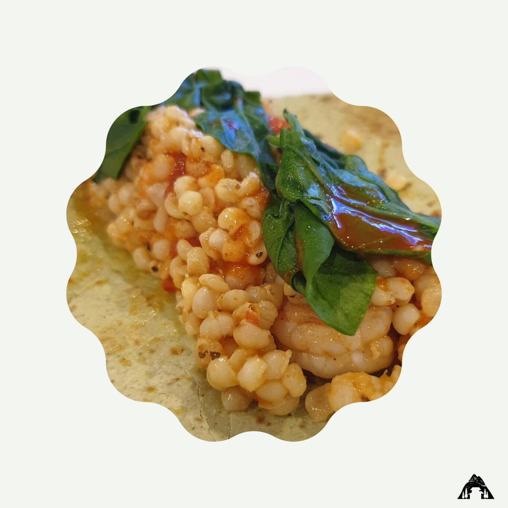 This healthy shrimp burrito is made with adlai and topped with steamed spinach