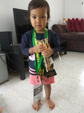 founder of ash be nimble hui mathews brings back the trophy for baby asha
