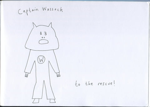 Scan of an A4 sketchbook page. Captain Wassock is crudely drawn in black pen outline. Captain Wassock has an oversize helmet in the shape of a tea-cosy, with cat-like ears at the top and a gormless open-mouthed expression cut out for eyes nose and mouth. Captain Wassock is standing face-on to the camera, legs slightly splayed and arms hanging down awkwardly at a slight distance from Captain Wassock's waist. The trouser legs of Captain Wassock's suit are slightly flared and Captain Wassock's footwear looks a bit like hooves. There is a big W in a circle on Captain Wassock's chest. Hand-scrawled above the Captain are the words 'Captain Wassock' and, lower down, slightly to the right of the Captain as we see it: 'to the rescue!'
