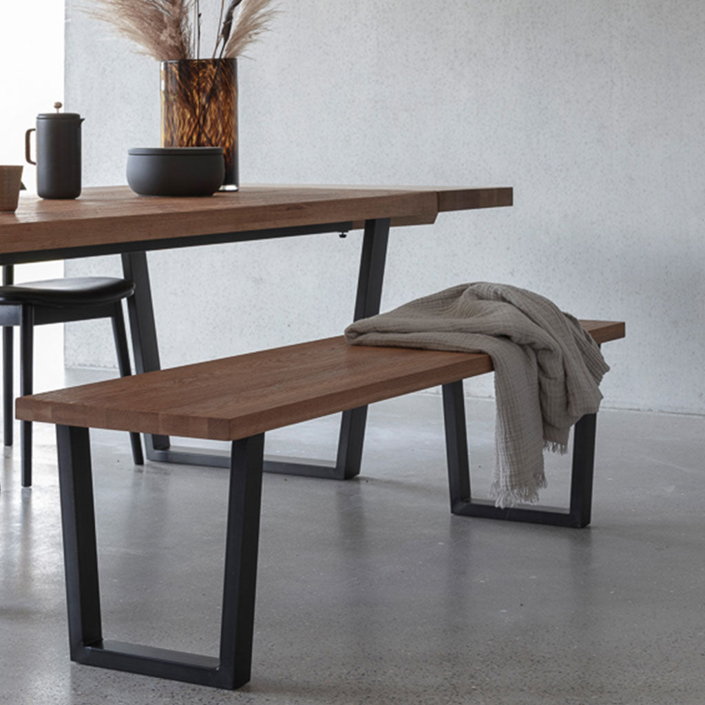 Industrial inspired dining setting with Calia table and oak bench seat