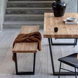 Calia dining bench seat paired with Calia table