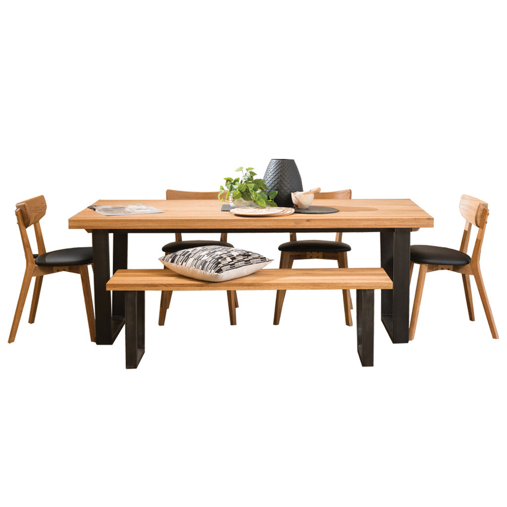 Calia table paired with Calia bench seat and Pisa dining chairs